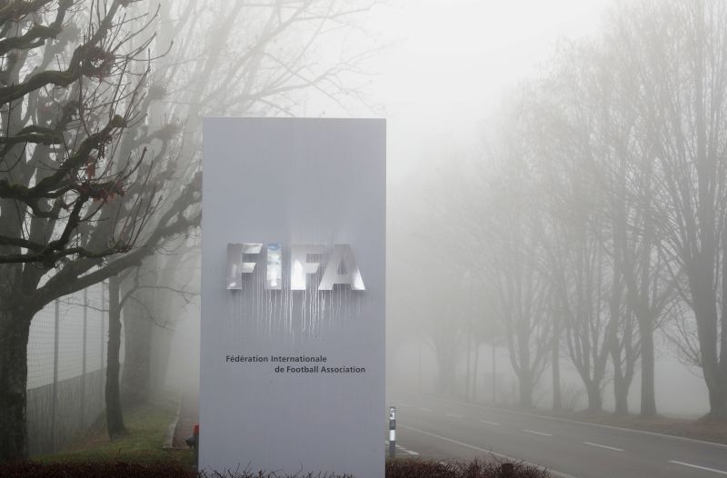 FILE PHOTO: FIFA's logo is seen in front of its headquarters during a foggy autumn day in Zurich, Switzerland November 18, 2020. REUTERS/Arnd Wiegmann/File Photo