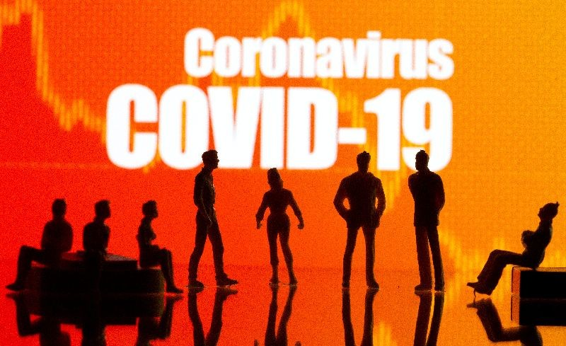 Small toy figures are seen in front of a Coronavirus Covid-19 and stock graph logo in this illustration taken, September 9, 2020. REUTERS/Dado Ruvic/Illustration