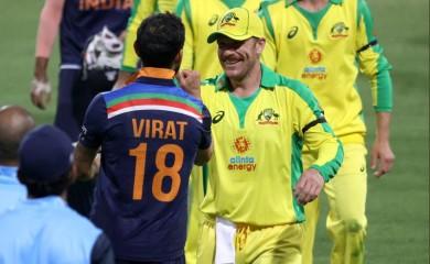 Cricket - First One Day International - Australia v India - Sydney Cricket Ground, Sydney, Australia - November 27, 2020  India's Virat Kohli and Australia's Aaron Finch after the match   REUTERS/Loren Elliott
