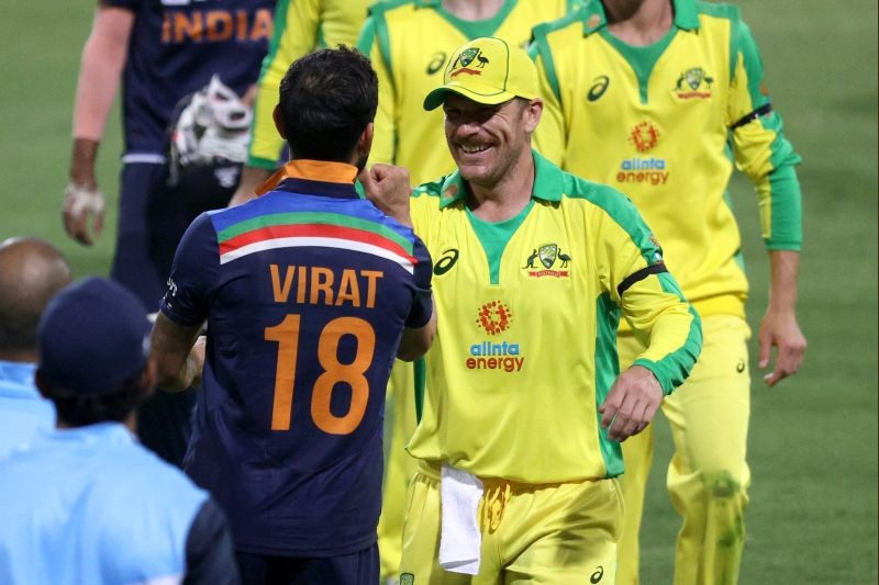 Cricket - First One Day International - Australia v India - Sydney Cricket Ground, Sydney, Australia - November 27, 2020  India's Virat Kohli and Australia's Aaron Finch after the match   REUTERS/Loren Elliott