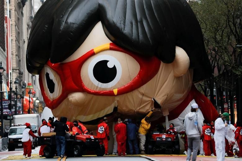 "A balloon depicting Red Titan, a character from ""Ryan's World"", is seen during the 94th Macy's Thanksgiving Day Parade closed to the spectators due to the spread of the coronavirus, in Manhattan, New York City, November 26, 2020. REUTERS/Andrew Kelly"