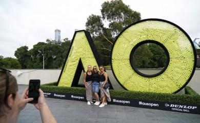 Tennis - Australian Open - First Round - Melbourne Park, Melbourne, Australia - January 20, 2020 - Fans pose with an Australian Open logo. REUTERS/Kim Hong-Ji