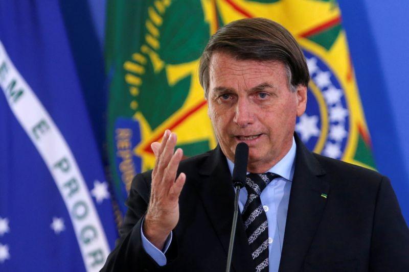 Brazil's President Jair Bolsonaro speaks during a ceremony at the Planalto Palace in Brasilia, Brazil November 26, 2020. REUTERS/Adriano Machado
