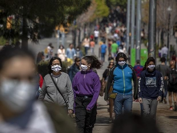 Families walk along a boulevard in Barcelona, Spain, as the lockdown to combat the spread of coronavirus continues.   Photo: AP/PTI