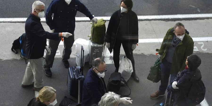 Members of a WHO team arrives in Wuhan in central China's Hubei province on Thursday, Jan. 14, 2021. (Photo | AP)