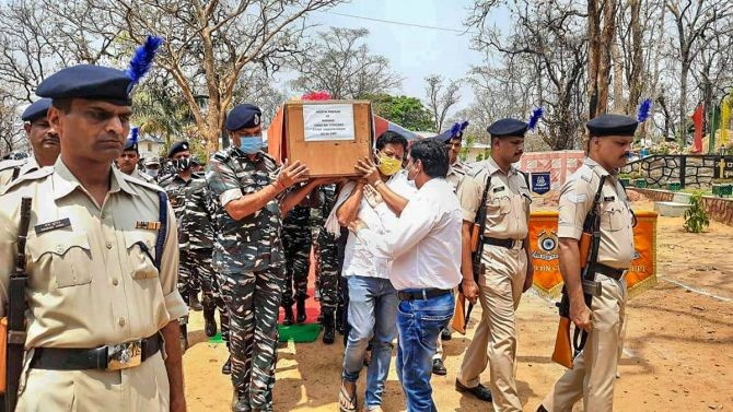 CRPF personnel carry the coffin of a jawan who lost his life in an encounter with Maoists, in Bijapur district of Chhattisgarh, on Sunday. Photograph: PTI Photo