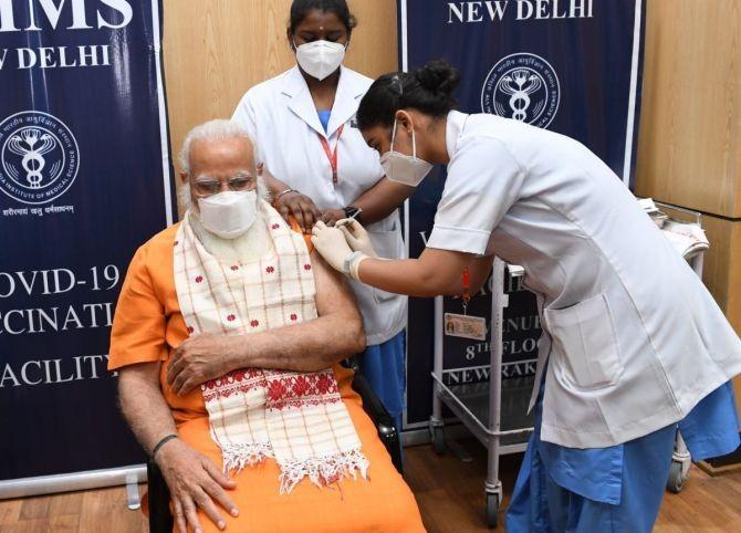 Prime Minister Narendra Modi takes his second dose of COVID-19 vaccine at AIIMS, New Delhi, on Thursday. Photograph: Kind courtesy @narendramodi/Twitter