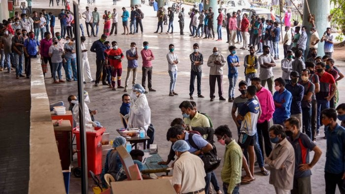 People queue up to give samples for Covid-19 test via RT-PCR, at Turbhe Railway Station in Navi Mumbai, Thursday, April 8, 2021. Credit: PTI Photo