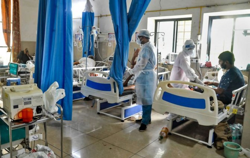 Medics check on COVID-19 patients at a hospital, amid a growing concern over shortage in supply of medical oxygen, in Sangli. Photograph: PTI Photo