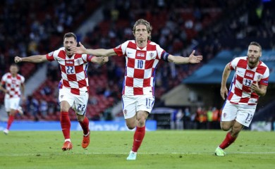 Croatia's Luka Modric, center, celebrates after scoring his side's second goal during the Euro 2020 soccer championship group D match between Croatia and Scotland at the Hampden Park Stadium in Glasgow, Tuesday, June 22, 2021.(Robert Perry/Pool via AP))