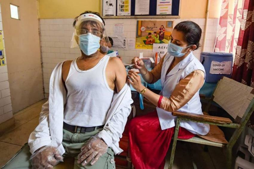 A health worker administers the second dose of the Covid-19 vaccine at a vaccination centre in New Delhi. PTI