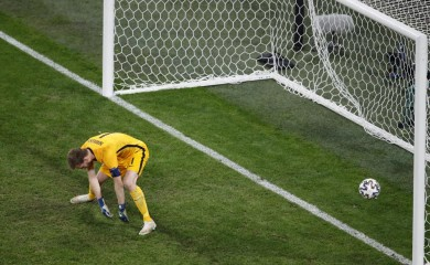 Finland's goalkeeper Lukas Hradecky fails to save the ball as Belgium's Romelu Lukaku scores his side's second goal during the Euro 2020 soccer championship group B match between Finland and Belgium at Saint Petersburg Stadium in St. Petersburg, Russia, Monday, June 21, 2021. (Anton Vaganov/Pool Photo via AP)