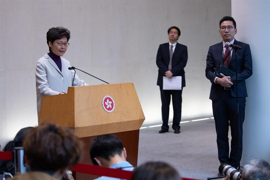 Hong Kong leader closes ranks with Beijing, condemns US law