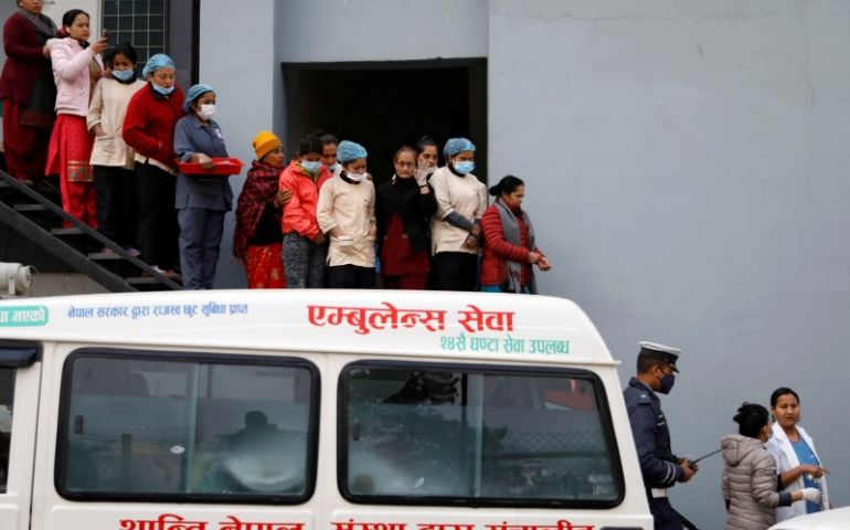 Hospital staff observe as the bodies of eight Indian tourists who died due to suspected suffocation are carried inside an ambulance while being taken for postmortem in Kathmandu, Nepal January 21, 2020. REUTERS/Navesh Chitrakar
