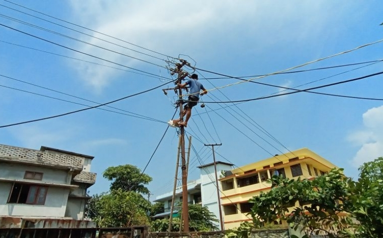 An power department employees is seen doing repair atop pole in Dimapur. (Morung File Photo)