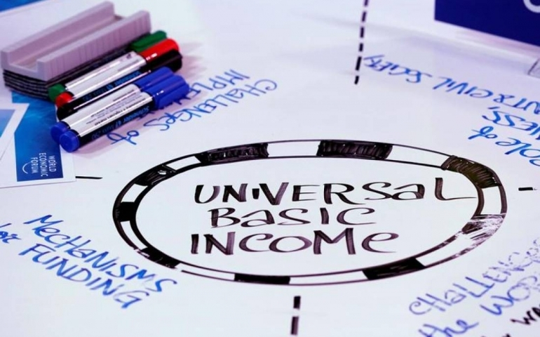 Universal Basic Income (UBI) is written on a table during a session at the World Economic Forum (WEF) annual meeting in Davos, Switzerland January 23, 2018 REUTERS/Denis Balibouse